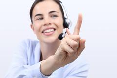 Contact us, customer service operator woman with headset, touch screen finger Stock Photos