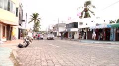 Puerto Ayora, main street, Av Charles Darwin, shot tracks taxi driving past and Stock Footage