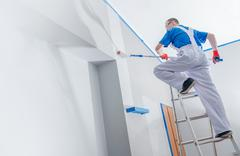 House Painting and Renovation Business Concept. Caucasian Male Painting House Stock Photos