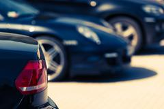 Luxury Cars For Sale Concept Photo. Car Dealer Lot. Parked Cars. - stock photo