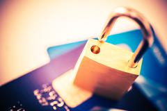 Not Safe Payments Concept. Padlock on Credit Cards Closeup Photo Concept. Stock Photos