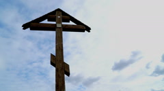 Orthodox cross on a background of blue sky Stock Footage