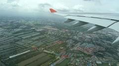 Aerial, airplane flies on Bangkok, Thailand Stock Footage