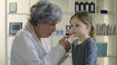 Little girl being examined by her Doctor - stock footage