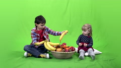 Children, fruits and green screen 4k  Stock Footage