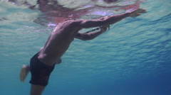 Local spearfisherman looking for fish, medium to wide, underwater, HD, UP27604 Stock Footage