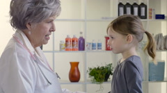 Doctor consulting with 5 year old patient - stock footage