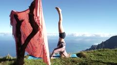 Beautiful Young Girl Model does Headstand Yoga Overlooking Beautiful Scenery - stock footage