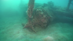 Ocean scenery WWII, World War 2 plane wreck upside down, shot swims past Stock Footage