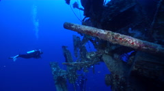 Group of scuba divers swimming on wreckage in Solomon Islands, HD, UP27739 Stock Footage
