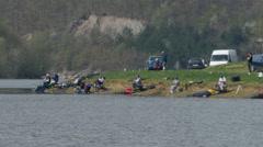 Panoramic shot of fishermen on the lake coast, fishing by Pakito. Arkistovideo