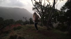 Beautiful Young Girl Model Wearing Pajamas Walks into Beautiful Paradise Stock Footage