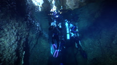 Group of scuba divers swimming in cavern in Solomon Islands, HD, UP27489 Stock Footage