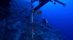 Male model scuba diver swimming on wreckage in Solomon Islands, HD, UP27737 Stock Footage