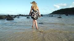 Beautiful Hawaiian Model Walks Barefoot Down Tropical Beach Into the Ocean - stock footage