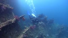 Female model scuba diver swimming on wreckage in Solomon Islands, HD, UP18415 Stock Footage