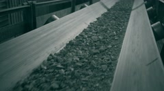 Ore move on conveyor in modern processing plant. shoot with slider Stock Footage