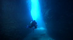 Point and shoot photographer swimming in cavern in Solomon Islands, HD, UP18602 Stock Footage