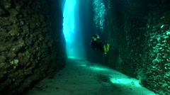 Colourful model scuba diver swimming in cavern in Solomon Islands, HD, UP18604 Stock Footage