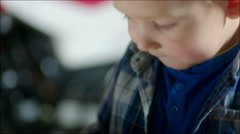 Little Boy and Jigsaw Puzzle - stock footage