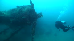 Lone diver exploring on wreckage in Solomon Islands, HD, UP18714 Stock Footage