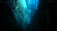 Chaotic hoard of scuba divers swimming in cavern in Solomon Islands, HD, UP18780 Stock Footage