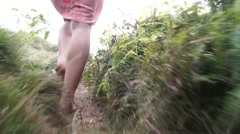 Model Hikes Barefoot in Dress Through Tropical Jungle Paradise Stock Footage