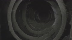 Ore mixed with water spinning inside a ball mill in copper processing industry Stock Footage