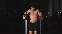 Man doing exercise at the press on the simulator Stock Footage