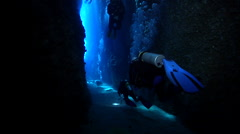 Group of scuba divers swimming in cavern in Solomon Islands, HD, UP18998 Stock Footage