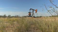 Industrial jack pump platform working on oil field in Texas - stock footage