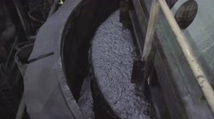 Water mixed with ore bubbles and shimmers in copper processing industry plant Stock Footage