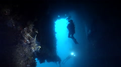Group of scuba divers swimming on wreckage in Solomon Islands, HD, UP28001 Stock Footage