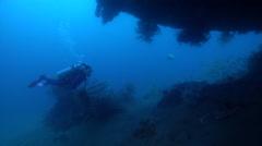 Female model scuba diver swimming on wreckage in Solomon Islands, HD, UP28033 Stock Footage