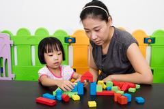 Asian Little Chinese Girl and Mother Playing Together - stock photo
