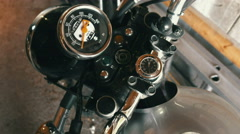 High angle shot of a man putting key into motorcycle ignition and turning it on. Stock Footage
