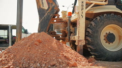 Tractor with a drilling device at a construction site Stock Footage