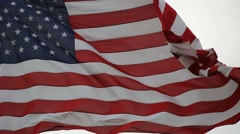 Flag of the United States of America flying high on a windy day close up 1080p Stock Footage