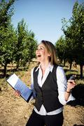 Woman with stopwatch in orchard. Stock Photos