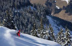 Man skiing down snow mountain slope Stock Photos