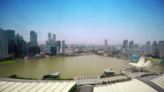 Panoramic view of Singapore. Business city view. Two boat moving in water. - stock footage