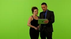 Man&woman slide ipad laugh greenscreen ms 4K Stock Footage