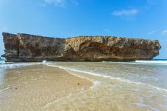 Rock on shore of Aruba - stock photo