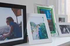 Photographs on a mantelpiece Stock Photos