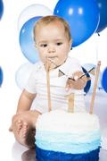 Baby smashing cake Stock Photos