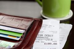A purse and receipts Stock Photos