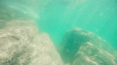 Underwater static camera scene nature background. Sand bottom with stones. Stock Footage