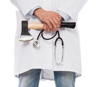 Evil medic holding a small axe Stock Photos