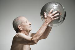 Senior man holding a globe Stock Photos