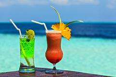 Two glasses of the soft drink are on a beach table (Maldives, The Indian Ocea - stock photo